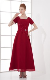 square-neck ankle-length short-sleeve dress with broach and ruching