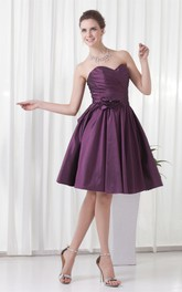 sweetheart knee-length criss-cross dress with pleats and flower