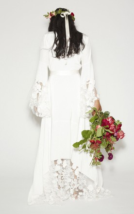 22d69886884 ... Simple Bohemian Long Sleeves Deep V Neck Hippie Beach Wedding Gown